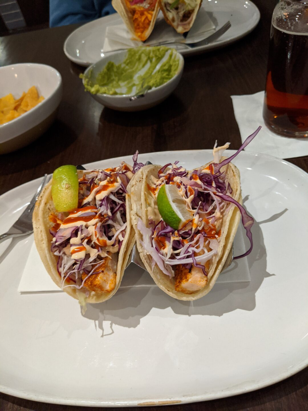 Two fish tacos on a plate.